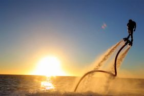 Watersports flyboard sunset